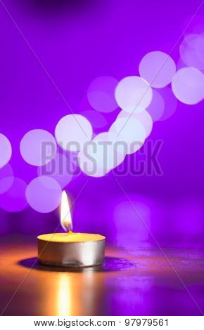 Tea Candle And A Pink Bokeh