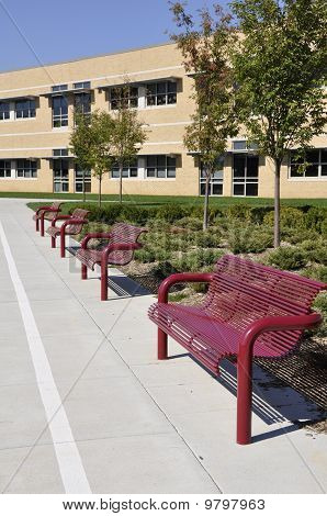 Several Empty Outdoor Benches