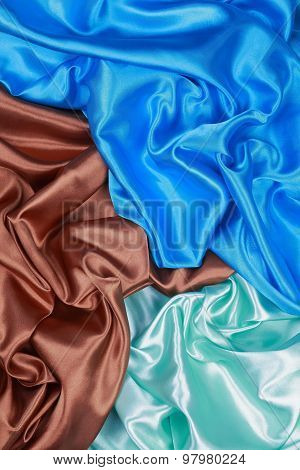 Brown And Light Green And Blue Silk Cloth Of Wavy Abstract Backgrounds
