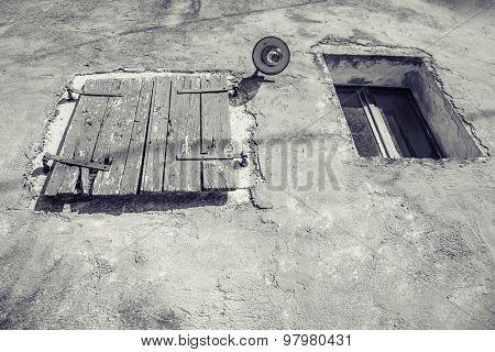 Weathered  window of old  abandoned stone cottage