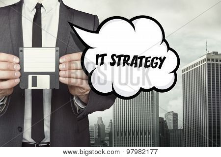IT strategy text on speech bubble with businessman holding diskette