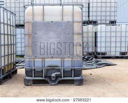 Plastic Oil Or Liquid Containers With Metallic Cage