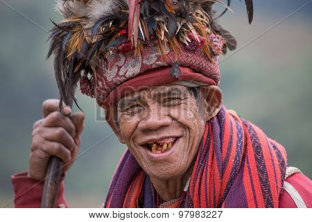 Old Ifugao Man In National Dress Next To Rice Terraces. Ifugao - The People In The Philippines.