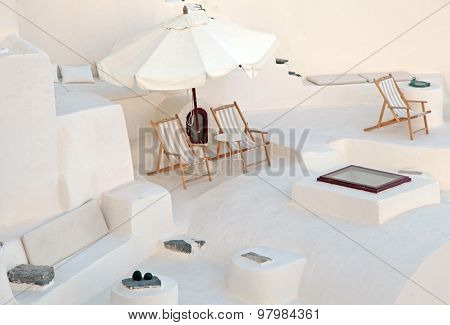 White Terrace With Deck Chairs In Caldera House, Santorini, Greece