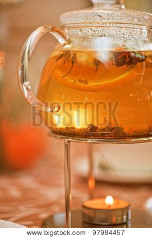 teapot of herbal tea on table