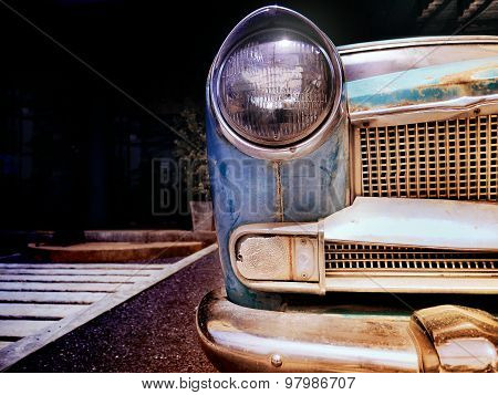 Detail Of The Front Headlight Of An Old Car In Vintage Retro Image.