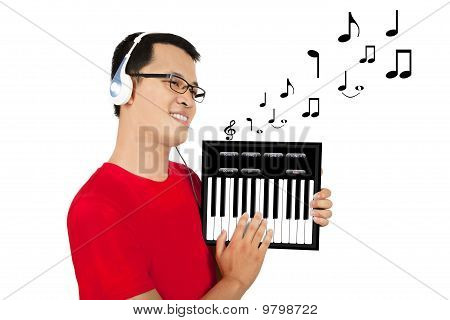holding a touchpad pc and Playing piano