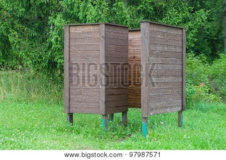 Wooden Wear Changing Cabin Near Coniferous Forest Recreational Area
