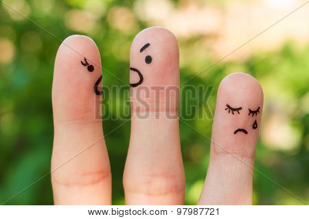 Finger art of family during quarrel. The concept of parents quarrel, child was upset.