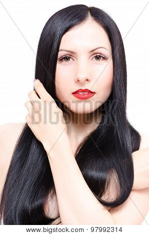 Portrait of a beautiful young woman with long groomed hair