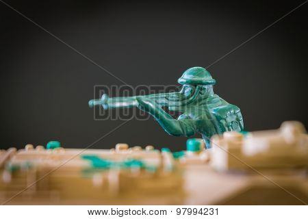 Closeup of action mini toy soldier on black background