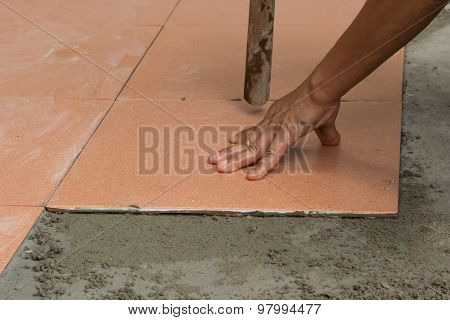 A Plasterer Is Tiling At Home, Tile Floor Adhesive Renovation At Home