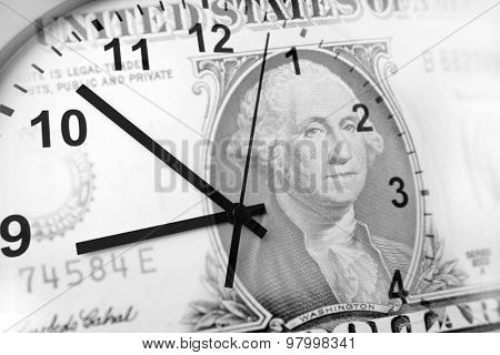 Clock and American banknote. Time is money