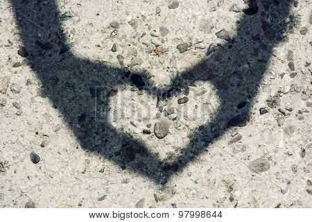 Young Woman Makes Heart Shadow With Her Hands