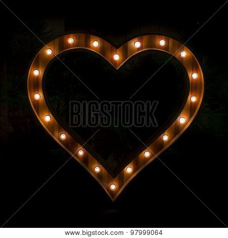 Heart Sign With Light Bulb Isolate On Black Background