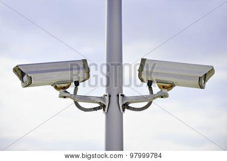 Surveillance Cameras On A Pole