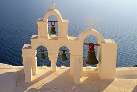 foto of blue-bell  - Bell tower of white church above the beautiful blue sea - JPG