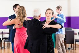 stock photo of senior class  - Group of people dancing in dance class having fun - JPG