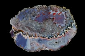 picture of agate  - A cross section of agate stone on a black background - JPG