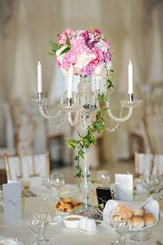 foto of wedding  - Antique candlestick with wedding bouquet - JPG