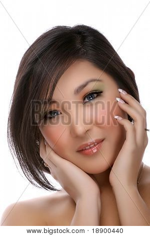 portrait of asian young woman wearing contact lenses isolated on white background