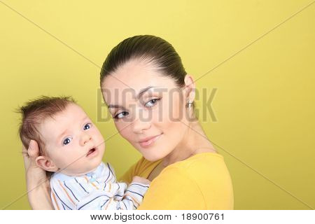 young mother and baby isolated on background