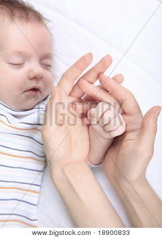 newborn caucasian pretty baby sleeping on white