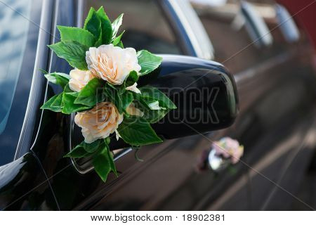 beautiful flower decoration on mirror of the car