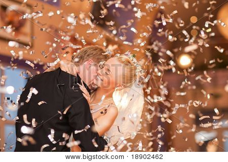 beautiful caucasian couple just married and dancing their first dance