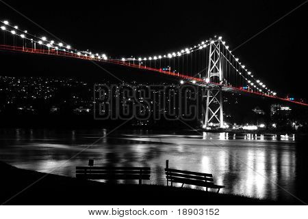 Night scene of Lions Gate in BC Canada. It's a black and white photo, beside, the traffic lights.