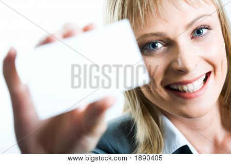 A Beautiful Woman Holding A Business Card