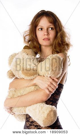 A young girl with her teddy-bear