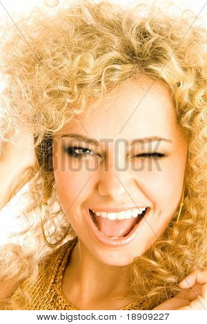 Young blond girl having fun and winking