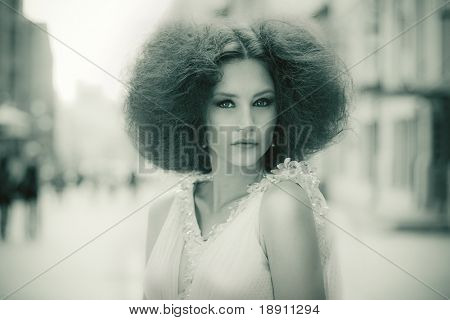 Stylized retro fashion portrait of a beautiful woman