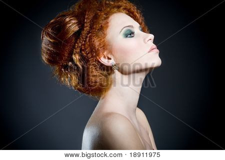 Beautiful redhead woman's profile. Perfect classy hair style and makeup.