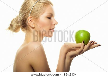 young woman with green apple over white