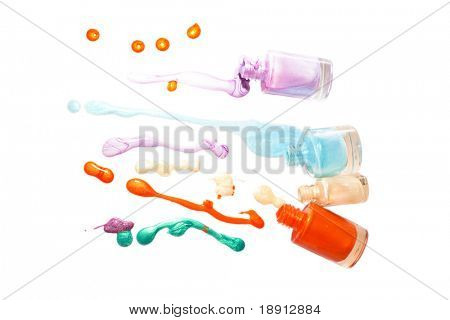 spilled nailpolish of different colors isolated on white