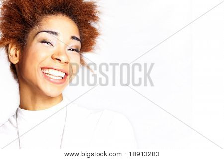 portrait of a smiling mulatto young woman over white background