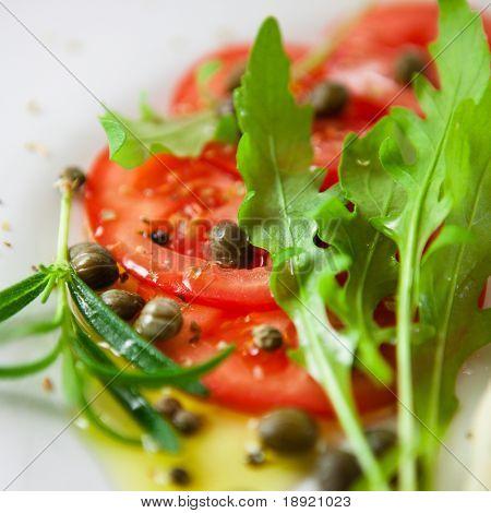 Tomato salad with arugula and caper dressing