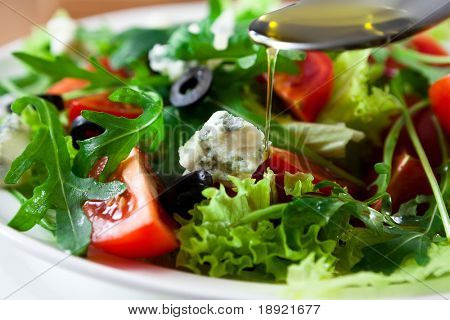 Mediterranean salad with gorgonzola and olive oil
