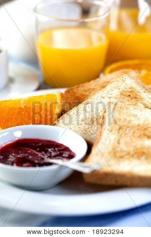 Breakfast with toasts and fruit jam
