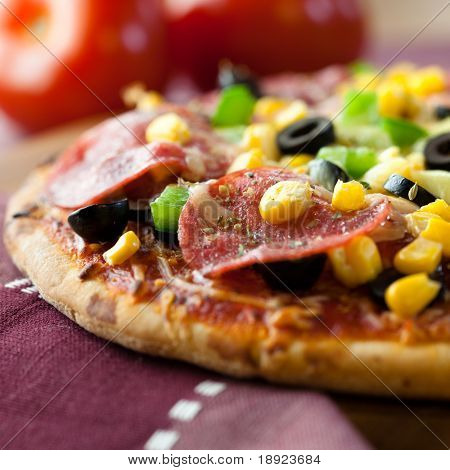 close up of pizza with salami