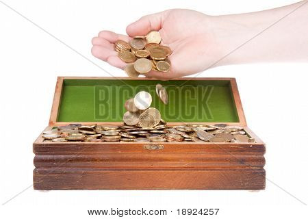Hand Dropping Coins In A Treasure Chest