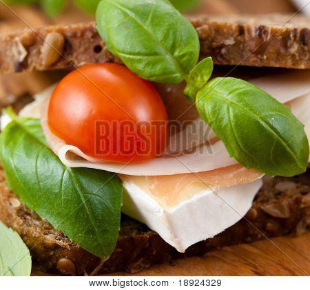 Sandwich with prosciutto crudo and brie