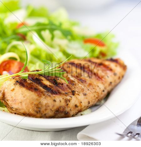 Grilled chicken fillet with fresh vegetable salad