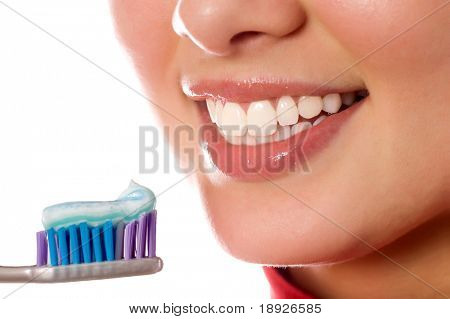 smiling young girl with tooth-brush (isolated on white)