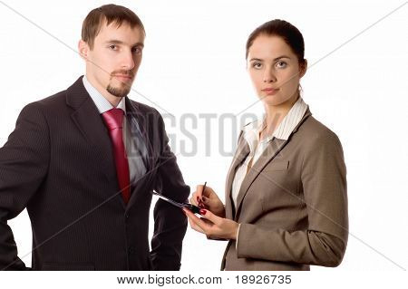 Young business man and woman working on a pda (isolated on white)