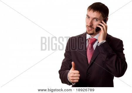 young modern business man/ student talking on cell phone, with thumbs up (isolated on white)