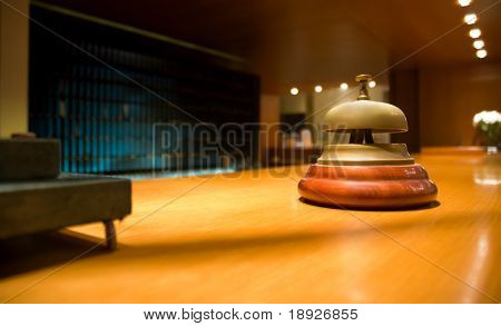 Brass bell on hotel reception (shallow dof)