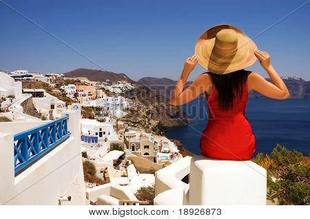 Beautiful young Greek woman on the streets of Oia, Santorini, Greece.